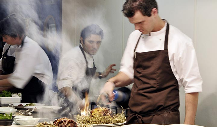 Noma Restaurant - Head of Chefs, Matthew Orlando putting the final touches to the lamb.